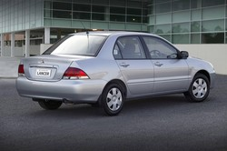 2003 mitsubishi chi lancer es sedan silver rear quarter australia